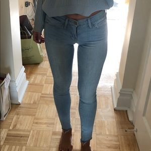 Frame jeans with frayed bottoms